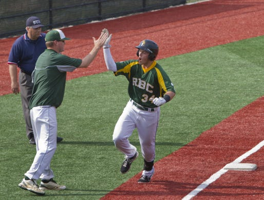 Mike Rescigno, shown being congratulated by Red Bank Catholic coach Buddy Hausmann in May, 2013, was both a pitching and hitting star for the Caseys.