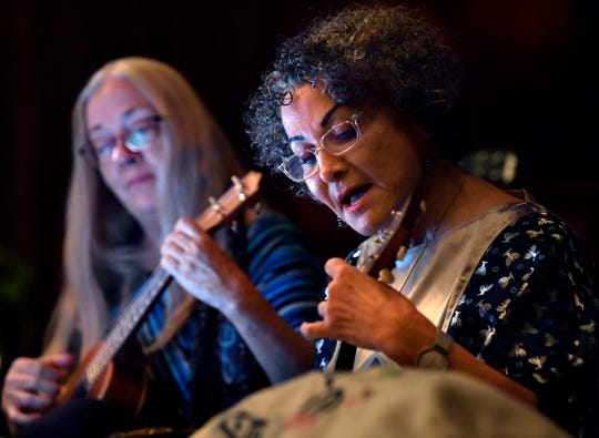 Cantor Monica O'Desky, right, is accompanied by Eliza Williams as they play music on ukuleles Friday at Temple Mizpah.