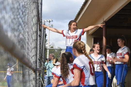 Madison's Brooklyn Franklin celebrates with her teammates in the dugout during their game against North Buncombe at the Andy Gregg softball field in Marshall on April 11, 2019. The Lady Patriots defeated the Lady Blackhawks 6-4.