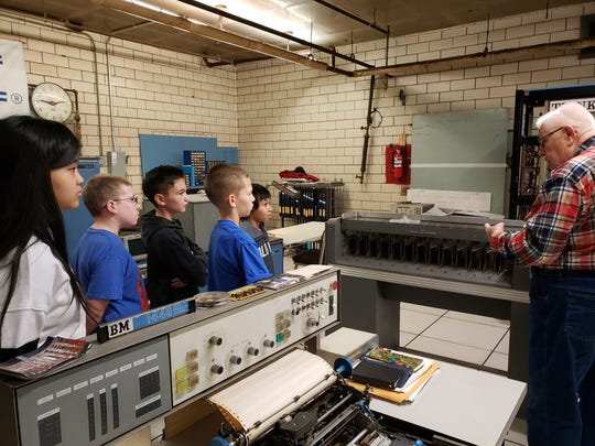 Dick Shipway talks to sixth grade pupils at Binghamton's West Middle School who visited  TechWorks! museum in downtown Binghamton recently.  He volunteers at the museum and several other places. His wife, Anita, is also an active volunteer.