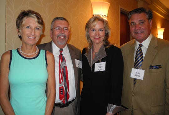 Vince Torpy, second from left, joins, from left,  Shelly Johnson, Morgan Reinman and John Alpizar at a Brevard County Legal Aid Pro Bono Awards Recognition Gala at the Hilton Melbourne Beach Oceanfront.