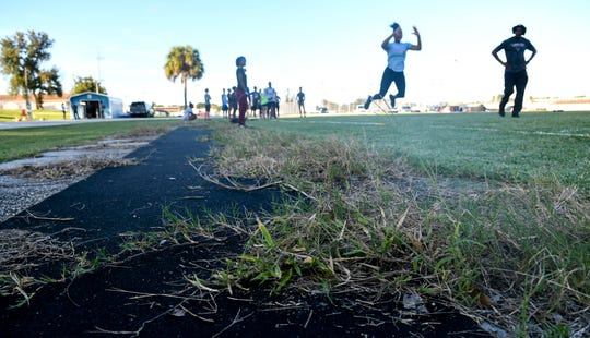 "The long jump runway at the Rockledge High track is overgrown with weeds from disuse. The facility has been given an ""F"" grade by the school board."