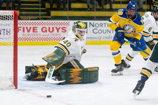 Vermont goalie Stefanos Lekkas (40) makes a save during the men's hockey game between the Lake Superior State Lakers and the Vermont Catamounts at Gutterson Field House on Sunday night December 29, 2019 in Burlington, Vermont.