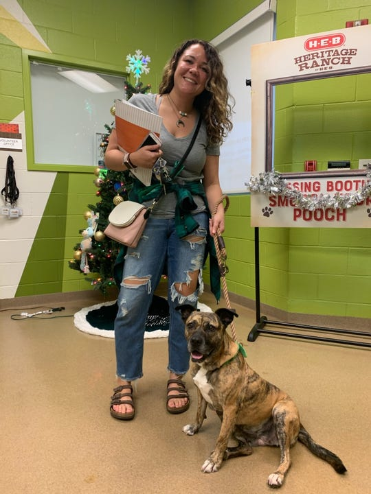 Briana Thomson, 27, decided to adopt Cocoa, a 5-year-old terrier mix, after fostering her for the holidays.