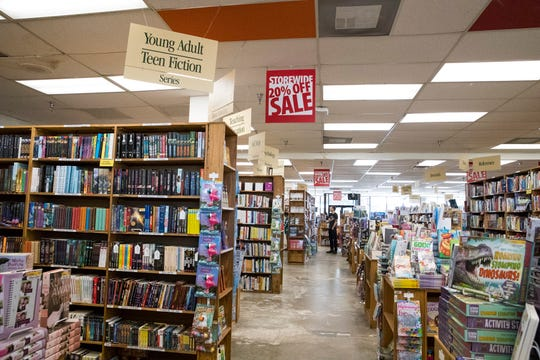 Customers shop at Half Price Books on Monday, Dec. 30, 2019. The store reopened Monday after a water main break forced it to close for a week.
