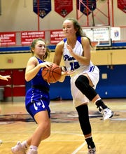 Maggie Jones (15) of Simon Kenton battrles her way to the hoop as the Lady Pioneers score a 72-47 win over Walton-Verona in the championship of the Ninth Annual LaRosa's Holiday Classic, Dec. 28, 2019.