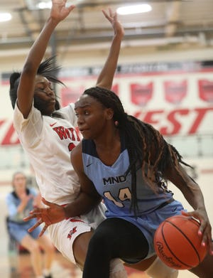 Mount Notre Dame's KK Bransford (14) drives to the basket during the Cougars' 51-47 win over Wayne, Sunday, Dec. 29, 2019.