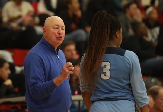 Mount Notre Dame head coach Scott Rogers talks with Makira Cook during the Cougars' 51-47 over Wayne, Sunday, Dec. 29, 2019.