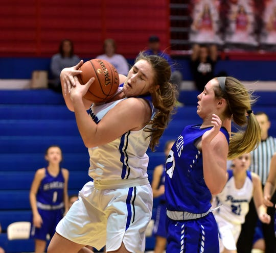 Morgan Stamper controls a rebound for Simon Kenton in the championship of the Ninth Annual LaRosa's Holiday Classic, Dec. 28, 2019.