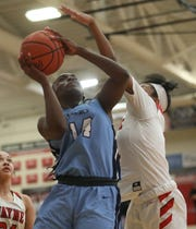 Mount Notre Dame guard KK Bransford drives to the basket during the Cougars  51-47 win, Sunday, Dec. 29, 2019.