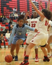 Mount Notre Dame guard Makira Cook (3) drives to the basket during the Cougars' 51-47 win, Sunday, Dec. 29, 2019.