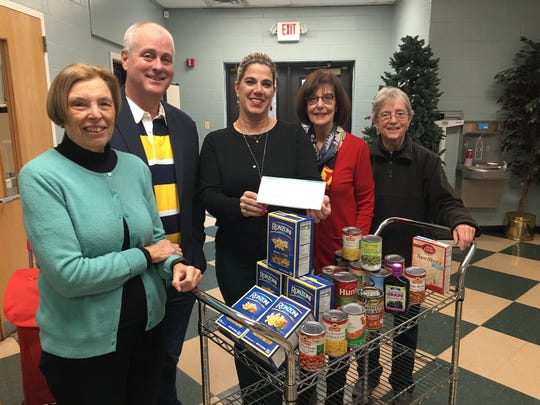 Unity Bank and its employees have donated a record total of $28,500 to 19 food pantries, including the Highland Park Community Food Pantry. Pictured (from left) during the check presentation are food pantry Chairperson Janice Ballou; Highland Park Councilman Matt Hale; Julia Homann, Unity Bank Relationship Manager; Highland Park Mayor Gayle Brill Mittler; and Nancy Lord, food pantry committee member.