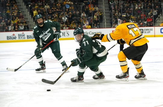 Michigan State's Logan Lambdin moves the puck against Michigan Tech during the second period of MTU's 4-2 win in the Great Lakes Invitational at Little Caesars Arena in Detroit on Monday, Dec. 30, 2019.