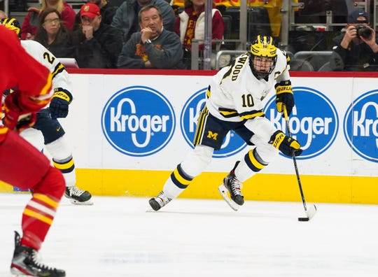 Michigan Wolverines forward Will Lockwood (10) moves the puck against Ferris State University during the 55th annual Great Lakes Invitational at Little Caesars Arena in Detroit on Monday, December 30, 2019.