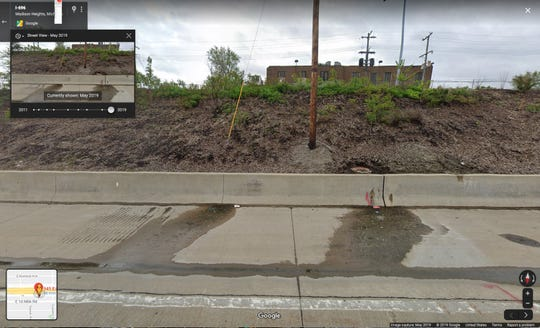 Google Maps street view image shows liquid coming from crevice on I-696 retaining wall in May of 2019.