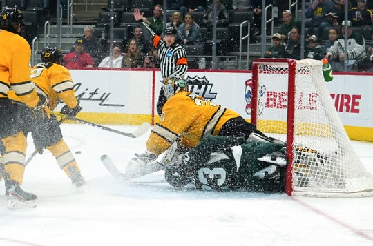Michigan State's Jagger Joshua slides into the goal against Michigan Tech during MTU's 4-2 win in the Great Lakes Invitational at Little Caesars Arena in Detroit on Monday, Dec. 30, 2019.