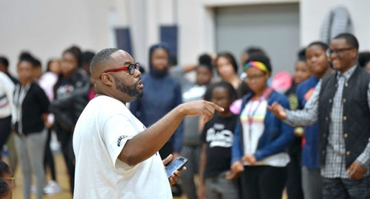 Anthony T. White, director of the Detroit Youth Choir, addresses the choir earlier this fall. The choir will hold auditions for new members on Saturday.