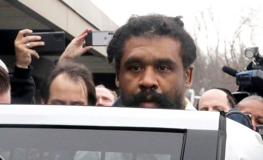 Grafton Thomas is led from Ramapo Town Hall in Ramapo, N.Y., following his arraignment Sunday, Dec. 29, 2019. Thomas was charged in the stabbings of five people as they gathered to celebrate Hanukkah at a rabbi's home in Monsey, an Orthodox Jewish community north of New York City.