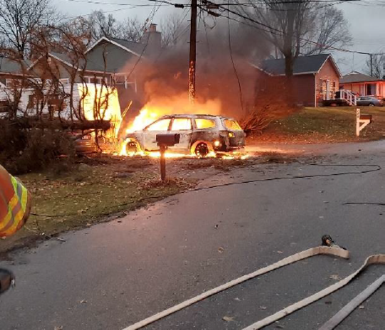 Downed powerlines came down over a parked vehicle in Auburn Hills and sparked a fire.
