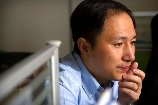 In this Oct. 10, 2018, photo, scientist He Jiankui looks at a computer screen while working at a lab in Shenzhen in southern China's Guandong province. China's government on Thursday, Nov. 29, 2018, ordered a halt to work by a medical team that claimed to have helped make the world's first gene-edited babies.