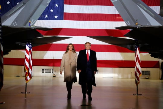 In this Dec. 20, 2019, file photo, President Donald Trump arrives with first lady Melania Trump to sign the National Defense Authorization Act for Fiscal Year 2020 at Andrews Air Force Base, Md.