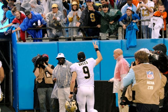 New Orleans Saints quarterback Drew Brees (9) waves to fans following the game.