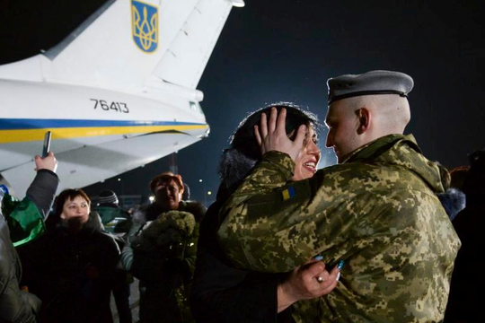 Yulia embraces her husband Olexander Korinkov, Ukrainian soldier and prisoner of war, right, released after a prisoner exchange upon his arrival at Boryspil airport, outside Kyiv, Ukraine, on Sunday.