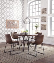 Spend some time in a different spot in your home like a breakfast nook that offers another place to get some work done.