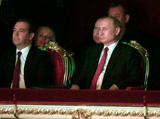 Russian President Vladimir Putin, right, and Prime Minister Dmitry Medvedev attend a gala on the occasion of the New Year at the Bolshoi Theater in Moscow, Russia, Thursday, Dec. 26, 2019.