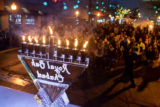 A menorah made from ice has all eight candles lit during an outdoor Hanukkah celebration, in Royal Oak, December 29, 2019.