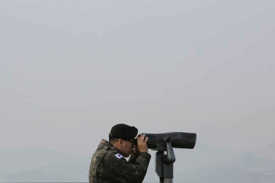 A South Korean army soldier watches the North Korea side from the Unification Observation Post in Paju, South Korea, near the border with North Korea, Wednesday, Dec. 25, 2019.