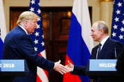 In this file photo taken on Monday, July 16, 2018, U.S. President Donald Trump shakes hand with Russian President Vladimir Putin at the end of the press conference after their meeting at the Presidential Palace in Helsinki, Finland. Putin called Trump on Sunday, Dec. 29, 2019, to thank him for intelligence that helped prevent terrorist acts as the country prepares to celebrate the New Year's holidays.