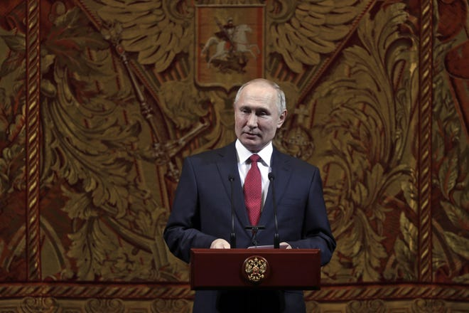 Russian President Vladimir Putin delivers his speech at a gala on the occasion of the New Year at the Bolshoi Theater in Moscow, Russia, Thursday, Dec. 26, 2019.