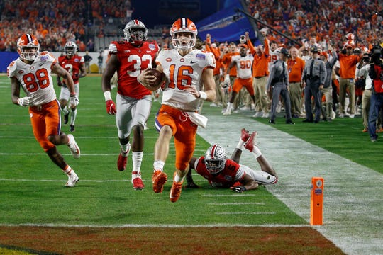 Clemson quarterback Trevor Lawrence reaches the end zone on a 67-yard touchdown run against Ohio State Saturday night.