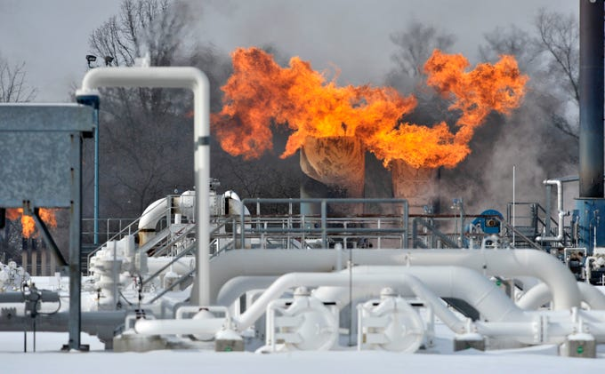 Fire pours out of two structures at Consumer's Energy's Ray Compressor Station in Armada Twp. on Jan. 30, 2019, after an explosion near the rear of the facility. The fire crippled the facility, which supplies 64% of Consumers' natural gas, leading the company to ask some large industrial customers to shut down and Gov. Gretchen Whitmer to ask residents to turn down their thermostats to preserve a suddenly constricted supply.