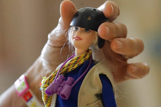 """This Dec. 3, 2019, photo taken on the University of Utah campus in Salt Lake City shows one of the """"treetop Barbies"""" ecologist Nalini Nadkarni created outfitted with miniature versions of her own gear. Fifteen years after she began making the dolls, Mattel asked her to consult on a new line of Barbies with careers in science and conservation."""