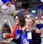 Gov. Gretchen Whitmer, left, and U.S. Rep.  Debbie Dingell share a laugh while making pancakes at The Pancake Breakfast presented by Blue Cross Blue Shield of Michigan at The Parade Company, November 8, 2019.