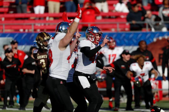Western Kentucky kicker Cory Munson, right, celebrates after kicking the  winning field goal in the final seconds to defeat Western Michigan in the First Responder Bowl on Monday in Dallas.