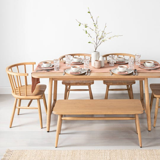 The Hearth & Hand with Magnolia Shaker Dining Table is now available at target.com.