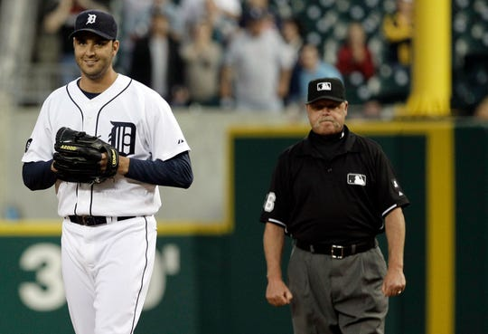Tigers pitcher Armando Galarraga smiles as he walks away from first base umpire Jim Joyce, who called the Indians' Jason Donald safe at first base with two outs in the ninth inning of a game June 2, 2010.