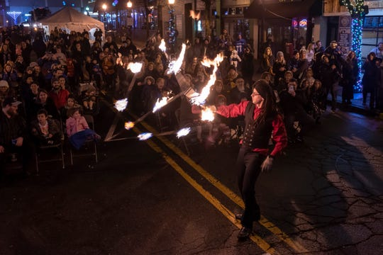 A member of the group Sunshine Fire Entertainment uses fire to entertain the audience during an outdoor Hanukkah celebration, in Royal Oak, December 29, 2019.