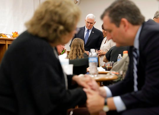 Vice President Mike Pence and his wife Karen, visit with family and victims of the shooting at the Sutherland Spring Baptist Church as Sen. Ted Cruz, foreground right, prays with a woman, Wednesday, Nov. 8, 2017, in Floresville, Texas.