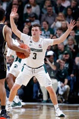Michigan State's Foster Loyer defends Western Michigan's B Artis White during the second half.