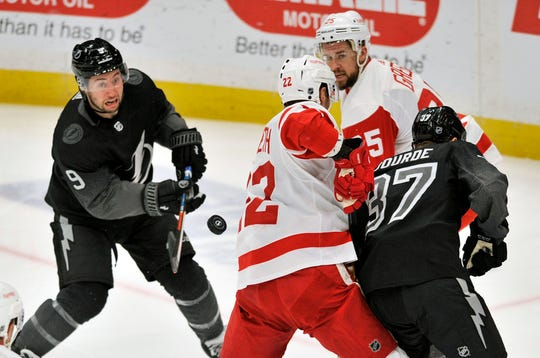 Tampa Bay Lightning center Tyler Johnson (9) tries to bat a deflected puck in front of Detroit Red Wings' Patrik Nemeth (22), Mike Green (25) and Tampa Bay's Yanni Gourde (37) during the first period.