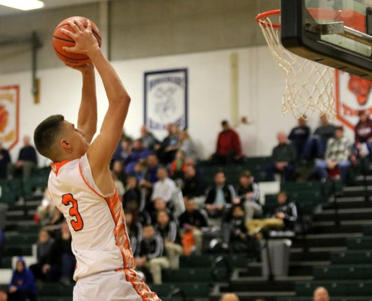 Max Jusianiec of Wellsville goes up for an unsuccessful dunk in a 59-54 loss to North Penn-Mansfield in the championship game of the Josh Palmer Fund Elmira Holiday Inn Classic on Dec. 30, 2019 at Elmira High School.