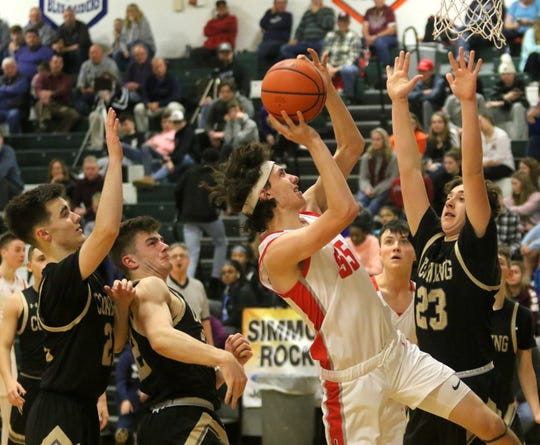 Lancaster's Joe Harrington goes up for a shot as Corning's Landen Burch defends during Lancaster's 56-55 win in the boys Regional Division 2 championship game at the Josh Palmer Fund Elmira Holiday Inn Classic on Dec. 30, 2019 at Elmira High School.