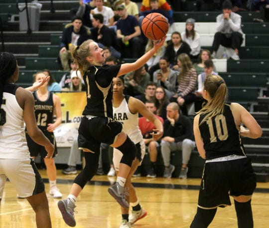 Ashlee Volpe of Corning drives for a layup against Cardinal O'Hara in a girls semifinal at the Josh Palmer Fund Elmira Holiday Holiday Inn Classic on Dec. 29, 2019 at Elmira High School.