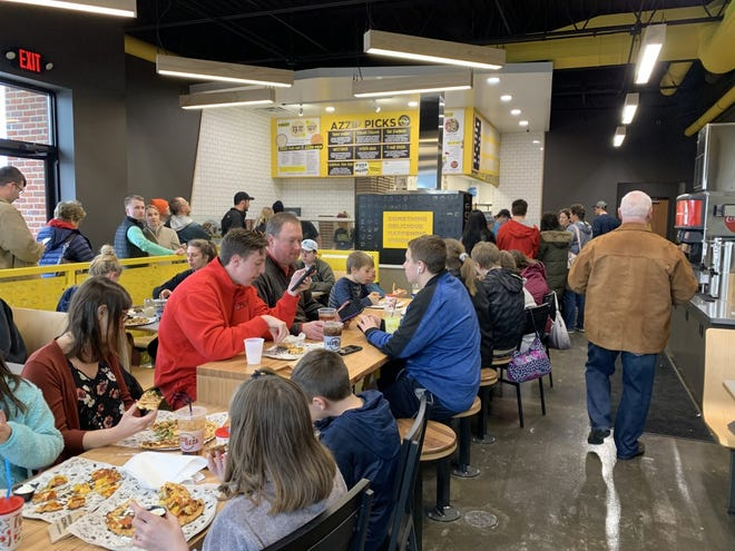 Azzip Pizza welcomes the community to the opening of the pizza chain's North Side location.