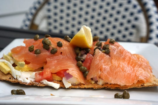 Survey Cafe's house-smoked salmon is not just reserved for bagels but also served as a dinner appetizers on the weekends