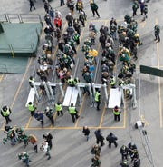 Fans go through security outside Lambeau Field before the start of the Green Bay Packers vs. Washington game on Dec. 8, 2019, in Green Bay, Wis.